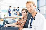 Portrait of doctor and patient undergoing medical treatment in outpatient clinic