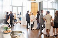 Group of conference participants standing in lobby of conference center, socializing during lunch break Stock Photo - Premium Royalty-Freenull, Code: 6113-07906108