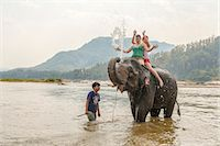 Laos, Luang Prabang. European tourists bathing with an elephant in the Mekong river (MR) Stock Photo - Premium Rights-Managednull, Code: 862-07910232