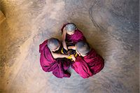 southeast asian ethnicity - Myanmar, Mandalay division, Bagan. Three novice monks with alms bowl, inside a pagoda (MR) Stock Photo - Premium Rights-Managednull, Code: 862-07910321