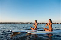 fitness   mature woman - Two women in lotus position on paddleboards, Mission Bay, San Diego, California, USA Stock Photo - Premium Royalty-Freenull, Code: 614-07911736