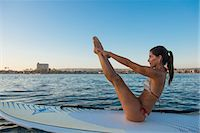 Mature woman in yoga position on paddleboard, Mission Bay, San Diego, California, USA Stock Photo - Premium Royalty-Freenull, Code: 614-07911737