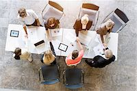 Overhead view of business team meeting clients at desk in office Stock Photo - Premium Royalty-Freenull, Code: 614-07911916