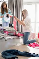 Sisters cleaning bedroom Stock Photo - Premium Royalty-Freenull, Code: 693-07912389