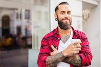 small business owners - Portrait of smiling owner with coffee outside candy store Stock Photo - Premium Royalty-Freenull, Code: 698-07944607