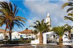 Village church Iglesia de San Martin and palm trees, San Bartolome, Lanzarote, Las Palmas, Canary Islands