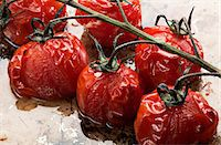 Roasted cherry tomatoes on a baking tray Stock Photo - Premium Royalty-Freenull, Code: 659-07958374