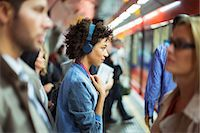 platform - Woman listening to headphones in train station Stock Photo - Premium Royalty-Freenull, Code: 6113-07961592