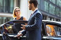 Chauffeur opening car door for businesswoman Stock Photo - Premium Royalty-Freenull, Code: 6113-07961628