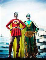 superhero - Superheroes standing on city rooftop Stock Photo - Premium Royalty-Freenull, Code: 6113-07961677