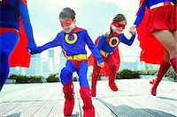 superhero - Family of superheroes running on city rooftop Stock Photo - Premium Royalty-Freenull, Code: 6113-07961680
