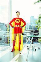 superhero - Superhero standing with hands on hips in office Stock Photo - Premium Royalty-Freenull, Code: 6113-07961703
