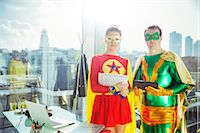 Superheroes standing in office Stock Photo - Premium Royalty-Freenull, Code: 6113-07961704