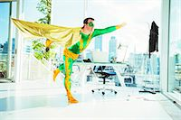 Superhero flying in office Stock Photo - Premium Royalty-Freenull, Code: 6113-07961711