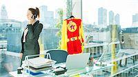 superhero - Businesswoman talking on cell phone with superhero costume behind her Stock Photo - Premium Royalty-Freenull, Code: 6113-07961742