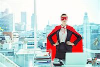 superhero - Businesswoman wearing cape and mask in office Stock Photo - Premium Royalty-Freenull, Code: 6113-07961745