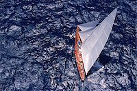 sailboat  ocean - Aerial View from Helicopter of Endeavour Racing off Coast of Antigua during 2001 Antigua Classic Yacht Regatta Stock Photo - Premium Rights-Managednull, Code: 700-07965868