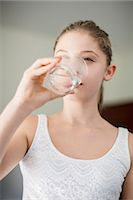 Girl drinking a glass of water Stock Photo - Premium Royalty-Freenull, Code: 6108-07969525