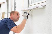 Man alone painting brush window wall house Stock Photo - Premium Royalty-Freenull, Code: 6121-07970027