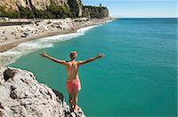 Teenager boy cliff holiday ocean waiting adventure Stock Photo - Premium Royalty-Freenull, Code: 6121-07970198