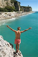 Boy cliff diving holiday risk holiday waiting Stock Photo - Premium Royalty-Freenull, Code: 6121-07970199