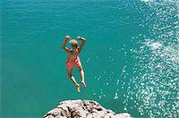 shirtless teen boy - Teenager water cliff sunshine summer holiday jump Stock Photo - Premium Royalty-Freenull, Code: 6121-07970201