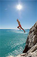 shirtless teen boy - Teenager risk danger ocean holiday jump dive water Stock Photo - Premium Royalty-Freenull, Code: 6121-07970202