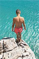 Waiting preparing teenager boy cliff diving Stock Photo - Premium Royalty-Freenull, Code: 6121-07970204