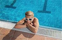 Blond teenager boy swimming pool sunglasses cool Stock Photo - Premium Royalty-Freenull, Code: 6121-07970214