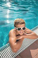 shirtless teen boy - Boy swimming pool sunglasses holiday relaxing Stock Photo - Premium Royalty-Freenull, Code: 6121-07970215