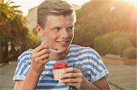 Teenager sunset eating ice cream summer Stock Photo - Premium Royalty-Freenull, Code: 6121-07970220