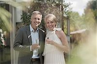 Man Woman couple married chic party attractive Stock Photo - Premium Royalty-Freenull, Code: 6121-07970234