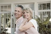 Couple married hugging garden portrait smiling Stock Photo - Premium Royalty-Freenull, Code: 6121-07970247