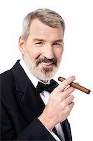Senior businessman posing with cigar Stock Photo - Royalty-Freenull, Code: 400-07984805