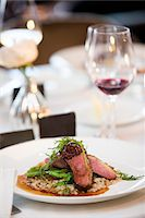 Beef with Arugula and Asparagus on Barley at Wedding Reception Stock Photo - Premium Royalty-Freenull, Code: 600-07991588