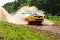 Rally car racing on dirt track Stock Photo - Premium Rights-Managednull, Code: 858-07992298