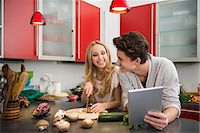Young couple preparing food in kitchen, Munich, Bavaria, Germany Stock Photo - Premium Royalty-Freenull, Code: 6121-07992516