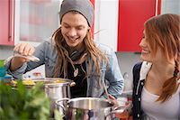 Young couple cooking together in kitchen, Munich, Bavaria, Germany Stock Photo - Premium Royalty-Freenull, Code: 6121-07992528