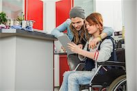 Young couple looking recipe in digital tablet, Munich, Bavaria, Germany Stock Photo - Premium Royalty-Freenull, Code: 6121-07992579