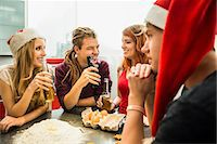 Group of friends preparing cake and drinking beer on Christmas Eve, Munich, Bavaria, Germany Stock Photo - Premium Royalty-Freenull, Code: 6121-07992582