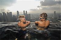 Teenage boys in an infinity pool, Marina Bay Sands, Singapore City, Singapore Stock Photo - Premium Royalty-Freenull, Code: 6121-07992641