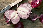 halved red onion on wooden table