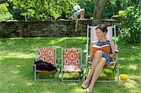 preteen girl pussy - Woman reading book on sun chair Stock Photo - Premium Royalty-Freenull, Code: 6102-08000909