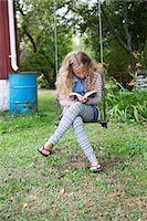 preteen thong - Girl on swing reading book Stock Photo - Premium Royalty-Freenull, Code: 6102-08001100