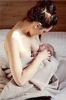 pregnant breast - Mother breastfeeding newborn baby Stock Photo - Premium Royalty-Freenull, Code: 632-08001739