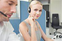 switchboard operator - Woman wearing phone headset at desk Stock Photo - Premium Royalty-Freenull, Code: 632-08001751