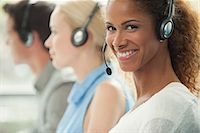 switchboard operator - Woman working in call center, smiling cheerfully Stock Photo - Premium Royalty-Freenull, Code: 632-08001864