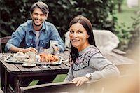 Portrait of happy couple having breakfast at organic farm Stock Photo - Premium Royalty-Freenull, Code: 698-08007900