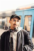 Thoughtful male university student standing at subway station Stock Photo - Premium Royalty-Freenull, Code: 698-08008129