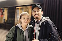 Portrait of happy young couple standing at subway station Stock Photo - Premium Royalty-Freenull, Code: 698-08008130